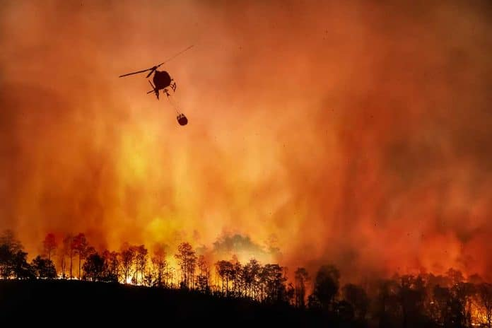 Evacuations Ordered Amid Massive Wildfires